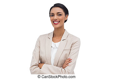 Cheerful businesswoman with arms cr
