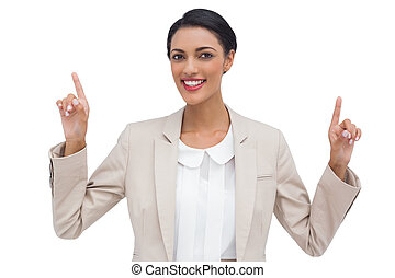 Smiling businesswoman with hands up against white background