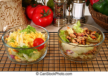 Lettuce and Pea Salads - Lettuce and black-eyed pea salads,...