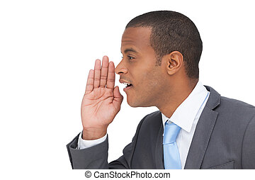 Profile view of a businessman calling for someone on white...