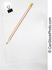 Note paper with pencil on notebook