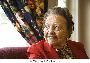 Elderly woman by window.