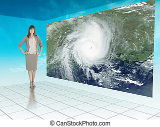 Businesswoman standing next to futuristic screen showing...