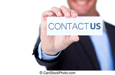 Businessman holding a label with contact us written on it on...