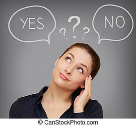 Business thinking woman with yes or on in speech bubble on...