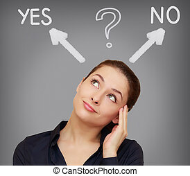 Business woman thinking yes or on grey background with...