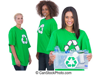 Female activist holding recycling box