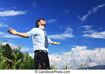 Freedom - Young business man enjoying the fresh air on a...