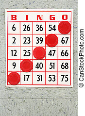 Winning bingo card. - Red bingo card with winning chips.