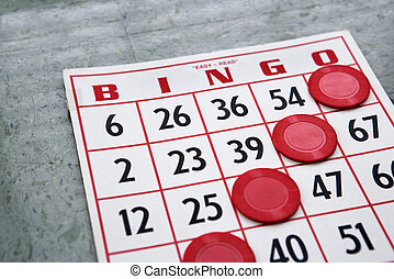 Winning game card. - Red bingo card with winning chips.