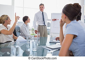 Businesswoman asking something during a meeting in the...