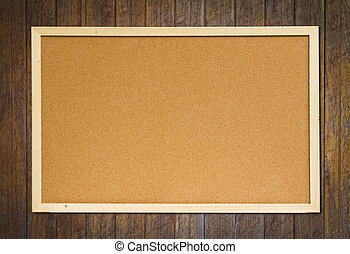 cork bulletin board on wood wall