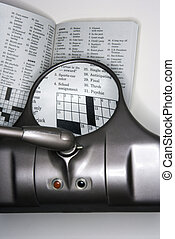 Magnified crossword puzzle. - Vision magnifying glass used...
