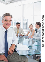 Smiling businessman during a meeting - Smiling businessman...