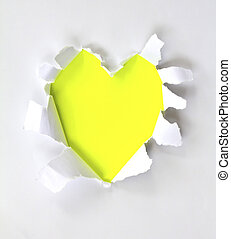 Sheet of paper with a Heart shape hole against bright yellow...