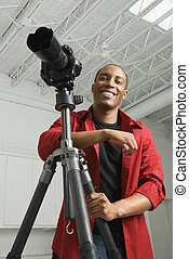 Photographer in studio - African American young male adult...