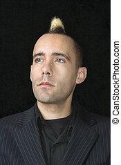 Businessman with mohawk. - Portrait of Caucasian man in suit...