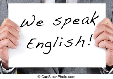 we speak english - a man wearing a suit holding a signboard...