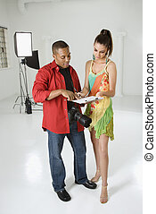 Model signing release form. - African American young male...
