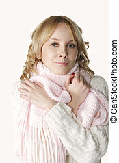 Chilly - Pretty blonde young woman in pink scarf feel chilly