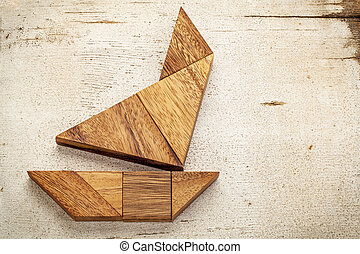 tangram sailboat - abstract picture of a sailing boat built...