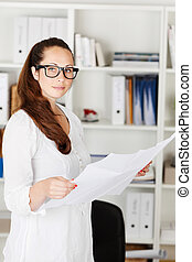 Attractive businesswoman with documents - Image of an...