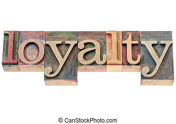 loyalty word in wood type - loyalty - isolated text in...