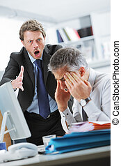 Yelling at an employee - Mature manager shouting at his...