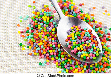 colorful sugar sprinkles in spoon