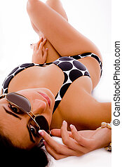 top view of sensuous woman holding her sunglasses with white...
