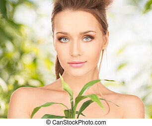 woman with sprout - picture of woman with sprout over green...