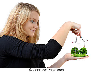 Girl holding in hands wind turbine