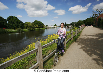 Smiling East Asian Woman with Bicycle on sunny day - Smiling...