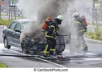 Firefighters are putting out a burning car - Burning motor...