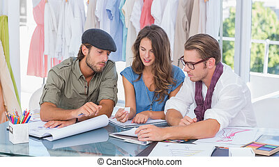 Fashion designers working in a office