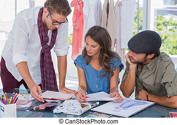 Fashion designer pointing a photo