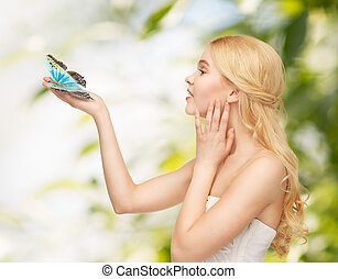 woman with butterfly in hand - picture of beautiful woman...