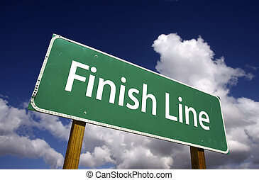 Finish Line Road Sign with Dramatic Clouds and Sky