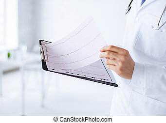 male doctor hands holding cardiogram - bright picture of...