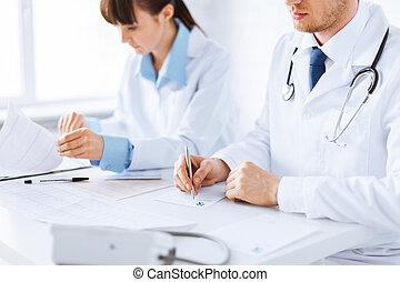 doctor and nurse writing prescription paper - picture of...
