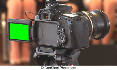 DSLR video with green screen - DSLR camera in recording mode...