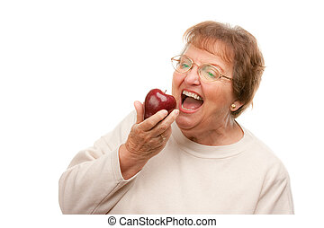 Senior Woman Eating - Attractive Senior Woman with Apple...