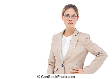 Businesswoman with glasses looking at the camera on a white...