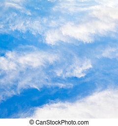 cloudscape with stratus clouds in blue sky in March, France