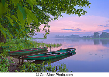 Morning haze over the river. - Two boats on Narew river....