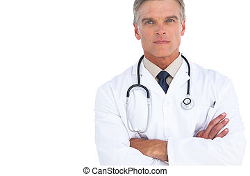Serious man doctor with arms crossed looking at the camera