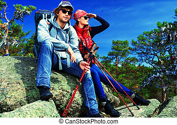travellers - Couple of tourists are sitting at the top of a...