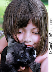 Little Girl and Her Mini Schnauzer - Little girl hugging her...