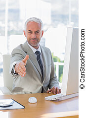 Happy businessman reaching out for