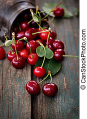 Fresh cherries - Fruit food concept. Fresh cherries on wood